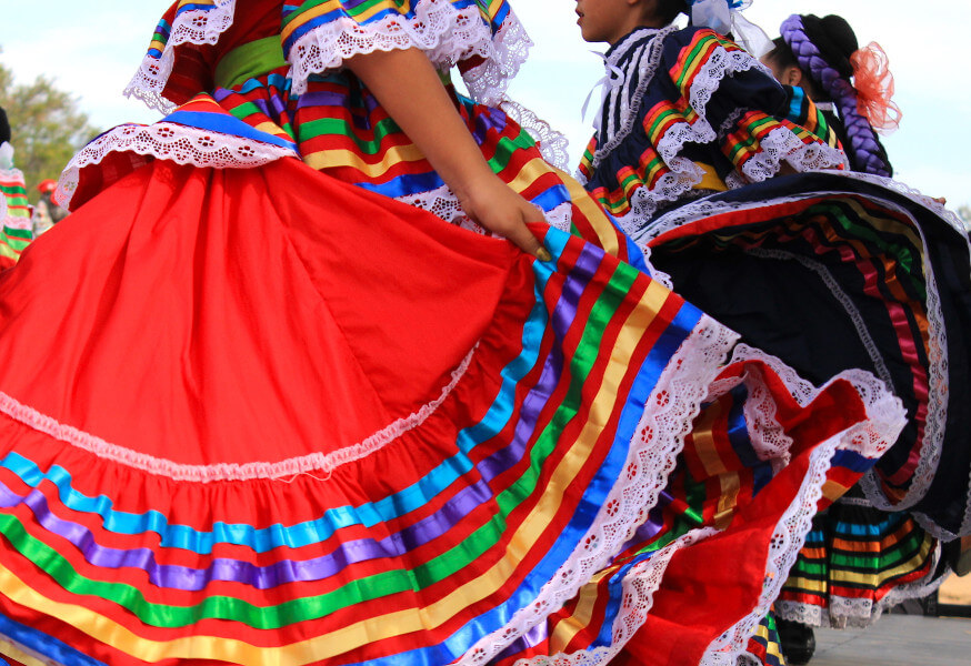 Girls dancing in big, brightly colorful skirts