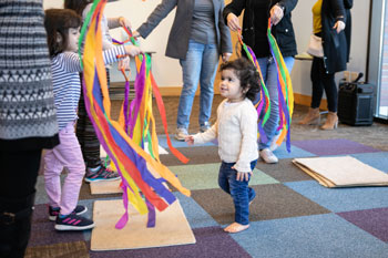 Children playing with ribbons at storytime